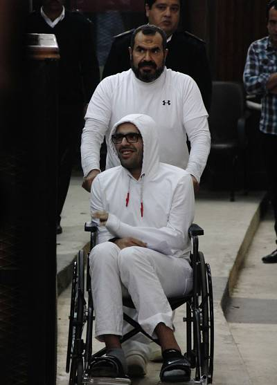 In this March 9, 2015 photo, Mohammed Soltan is pushed by his father Salah during a court appearance in Cairo, Egypt.