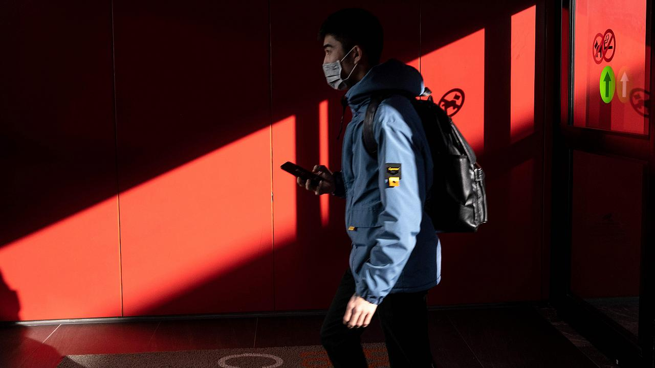 Image: A passenger from China's Hainan Airlines from Beijing walks out of t