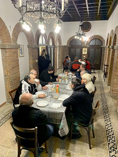 Resident\'s share a meal prepared for them by volunteers at the Palazzo Migliori, a 19th century palace which now serves as a homeless shelter.