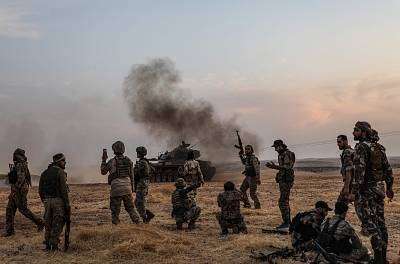Turkish soldiers and Turkish-backed Syrian fighters gather on the northern outskirts of the Syrian city of Manbij near the Turkish border in October.