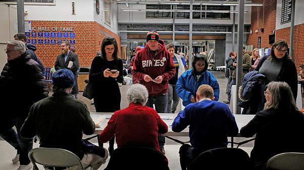 Iowans register at their caucus site in Des Moines on Feb. 3, 2020.
