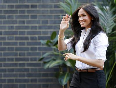 Meghan, the Duchess of Sussex, waves as she leaves an event in London on Sept. 12.