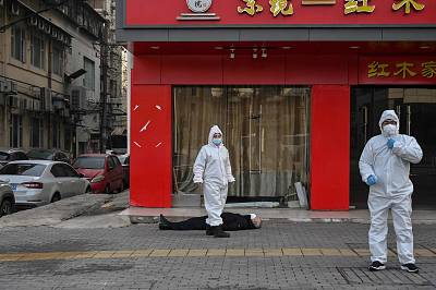 This elderly man collapsed and died on a street in Wuhan last month.