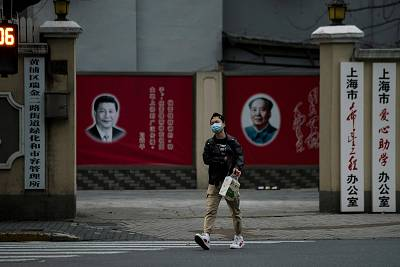 Portraits of Chinese President Xi Jinping and late Chinese chairman Mao Zedong on a street in Shanghai, China, on Feb. 10.