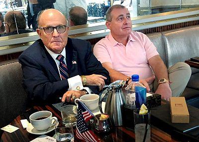 Rudy Giuliani has coffee with Ukrainian-American businessman Lev Parnas at the Trump International Hotel in Washington on Sept. 20, 2019.