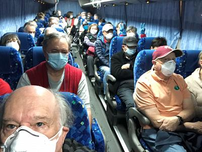 U.S. passengers on board the Diamond Princess cruise ship, who have chosen to leave, are transported by shuttle bus to Haneda airport to fly back to the United States. Courtesy of Philip and Gay Courter.