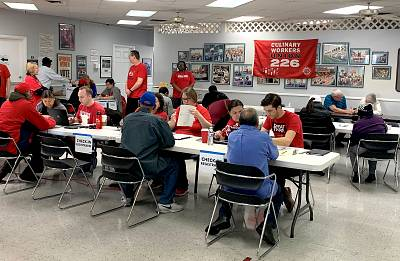 Union members help register voters and explain the early voting process at the Culinary Workers Union in Las Vegas on Monday, Feb. 17, 2020.