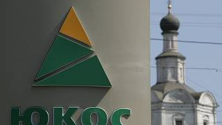 Image: The logo of Russian oil giant Yukos on a wall of a petrol station in