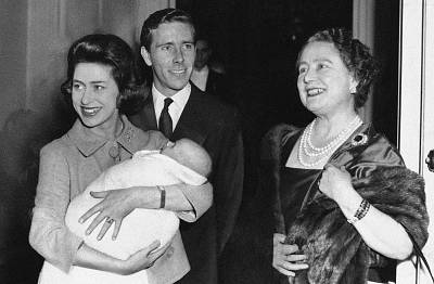 Queen Mother Elizabeth says goodbye to her daughter, Princess Margaret, and her son-in-law, Lord Snowdon, as they leave Clarence House in London on Nov. 30, 1961 with their infant son, Viscount Linley.