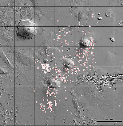 The U.S. Geological Survey\'s (USGS) Astrogeology Science Center has released the locations of more than 1,000 cave-entrance candidates on Mars. The dots indicate the location of possible caves in the Tharsis region on Mars.