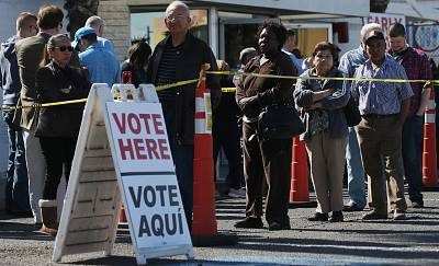 People wait in line on the final day of early voting for the upcoming Nevada caucuses on Feb. 18 in Las Vegas.