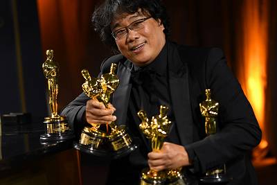 South Korean film director Bong Joon Ho poses with his engraved awards as he attends the 92nd Oscars Governors Ball at the Hollywood & Highland Center in Hollywood on Feb. 9, 2020.