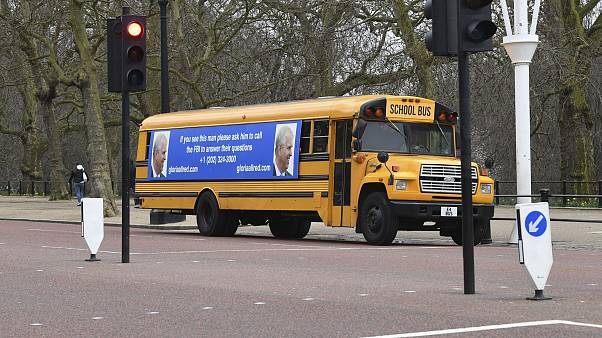 School bus draped with message targets UK's Prince Andrew