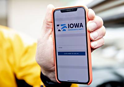 The Iowa Democratic Party caucus app is displayed on an iPhone outside Iowa Democratic Party headquarters in Des Moines, Iowa, on Feb. 4, 2020.