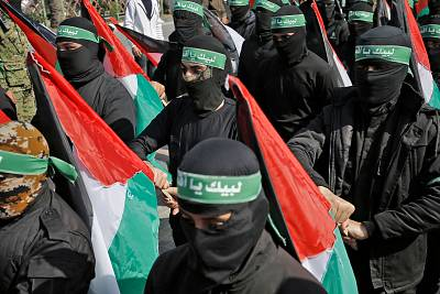 Masked Palestinian militants protest the US-brokered peace plan in Gaza City on Friday.