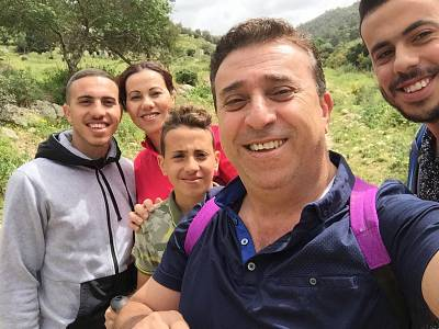 Mirvat Eghbarieh, back right, and her family.