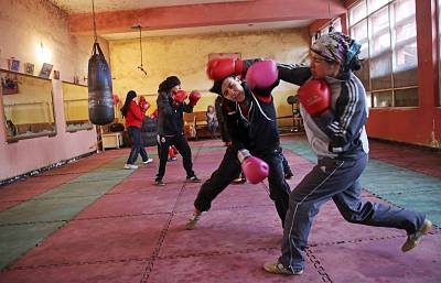 Afghan women boxers practice at the Kabul stadium boxing club on March, 5, 2014.