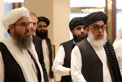 The Taliban\'s former envoy to Saudi Arabia Shahabuddin Delawar (L) arrives with Taliban negotiator Abbas Stanikzai (R), along with Taliban Qatar spokesman Suhail Shaheen (2nd-R), and the Taliban\'s former culture and information minister Amir Khan Mutaqi to attend the Intra Afghan Dialogue talks in the Qatari capital Doha on July 7, 2019.