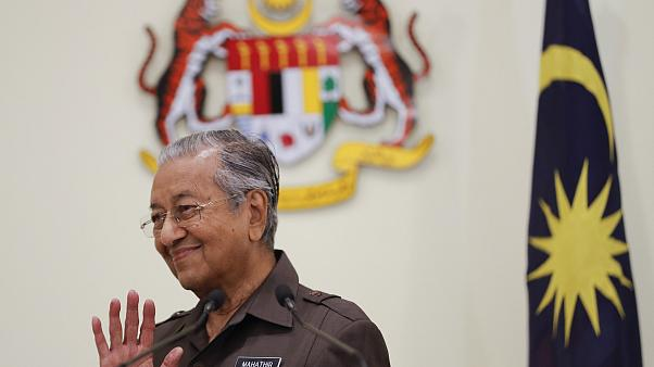 Image: Malaysian Prime Minister Mahathir Mohamad wave good bye to media aft