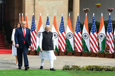 Prime Minister Narendra Modi, President Donald Trump and First Lady Melania Trump arrive at Hyderabad House in New Delhi on Tuesday.