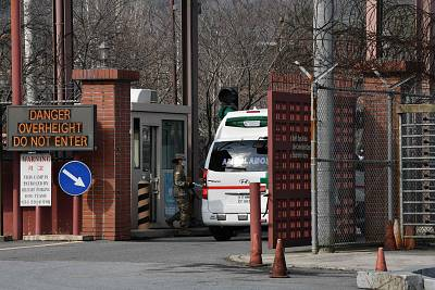 An ambulance drives through the main gate of US Army Camp Carroll in Chilgok, north of Daegu, on Wednesday.