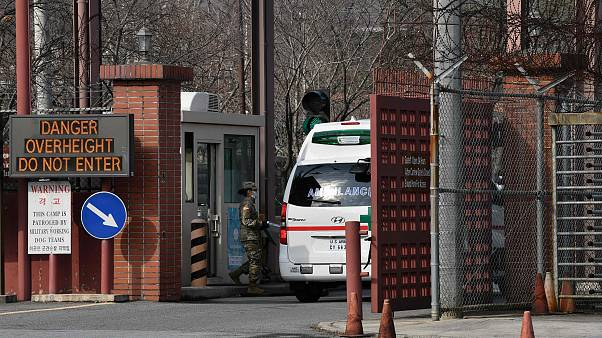 Image: An ambulance drives through the main gate of US Army Camp Carroll in