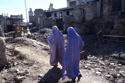 Women wear traditional burqas in Kabul, Afghanistan in 1996.