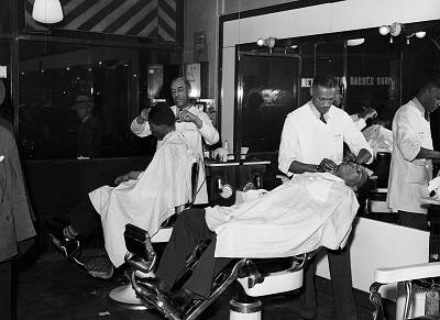 A black barbershop in Chicago in April 1941. Barbershops were also places where the community at large -- mainly black men -- and the barbers could talk about the most pressing issues.