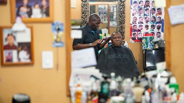 Image: Barber Anderson J. Washington with veteran Charles Peaks at CJ's Bar