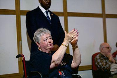 Elizabeth Jones, 69, applauds Sen. Elizabeth Warren during a rally in Orangeburg. Jones suffered a stroke without insurance, bankrupting her and her husband.