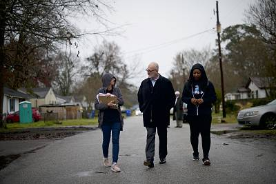 "Wendell Potter, a health insurance advocate, and Tawanya Herbert, right, canvass for ""Medicare for All"" in North Charleston, S.C."