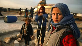 Image: Syrian children pose for a picture as their families prepare to flee