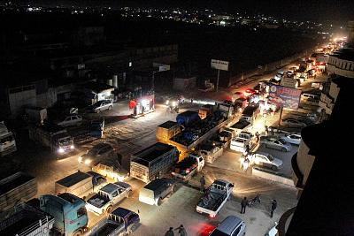 Heavy traffic flow along the road between the towns of Sarmada and Dana, as people flee advancing Syrian government forces.