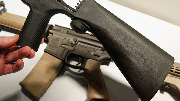Image: A bump fire stock that attaches to an semi-automatic assault rifle t