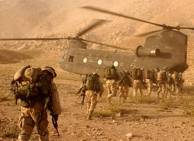 Soldiers of the U.S. 10th Mountain Division board a Chinook helicopter in the invasion of Afghanistan in 2001.