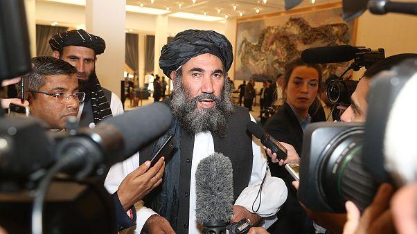 Image: Taliban leader Mullah Abdul Salam Zaeef, center, who served as ambas