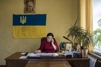 Inna Koba, chairwoman of the local council, talks on the phone in her office in Novi Sanzhary, Ukraine.