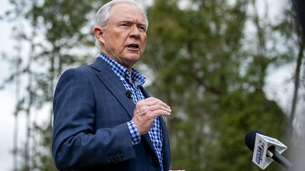 Image: Jeff Sessions speaks to reporters after voting in Alabama's primary