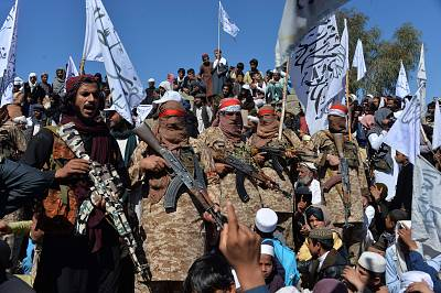 Afghan Taliban militants and villagers attend a gathering as they celebrate the peace deal and their victory in the Afghan conflict on U.S. in Afghanistan, in Alingar district of Laghman Province on March 2, 2020.