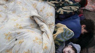 Image: Migrant children sleep on the pavement in Edirne near the Turkish-Gr