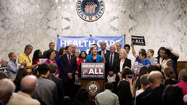 Image: Sen. Elizabeth Warren speaks alongside Sen. Bernie Sanders about Med