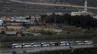 Image: Tourist buses wait at an Israeli checkpoint