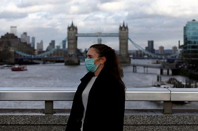 A woman wearing a protective face mask on London Bridge on Tuesday.