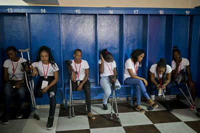Members of Haiti\'s amputee women\'s soccer team rest in the locker room before a soccer match against the Dominican Republic, in a game played to mark International Women\'s Day, in the Petion-Ville suburb of Port-au-Prince, Haiti, on Sunday. Haiti won the match 2-0.