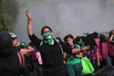 Woman gestures as participants mark International Women\'s Day in Mexico City, Mexico, on Sunday.