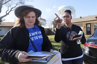 Democratic Party Precinct Chairs Angela Orr Heath, right, and Myla Senn prepare to walk a neighborhood during for a voter registration drive in Garland, Texas, on Jan. 18, 2020.