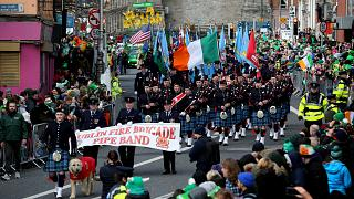 Image: Crowds watch the St. Patrick's Day Parade in Dublin, Ireland, on Mar