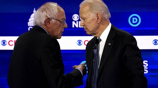 Image: Sen. Bernie Sanders and Joe Biden speak at a Democratic presidential