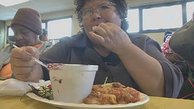 USA: homeless moms enjoy a Mother's Day meal