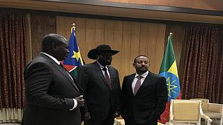 South Sudan's Salva Kiir and Riek Machar embrace at dinner hosted by Ethiopia PM